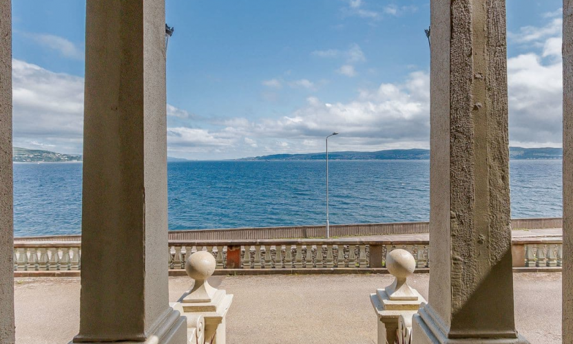 Looking out at the Clyde estuary on a sunny day from the entrance portico of Strone House