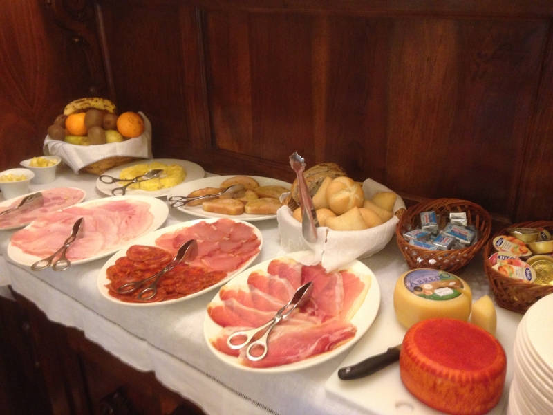 Breakfast is often set out as a buffet with cold cuts, fruits, cheeses and baked goods